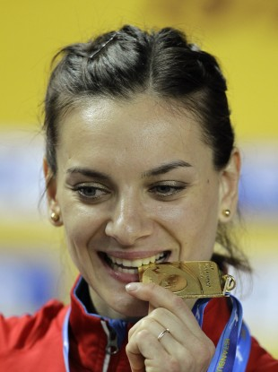 Isinbayeva bites her gold medal during the World Indoor Athletics Championships in Istanbul earlier this year.