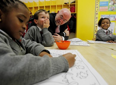 Education Minister Ruairí Quinn with school children in Dublin yesterday.