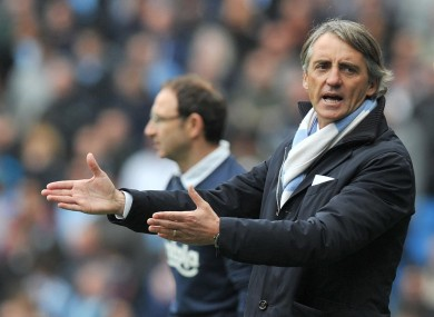 Roberto Mancini: title race is over if city lose at Arsenal, he says.