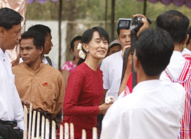 Suu Kyi, center, heads towards a polling station at Wah Thin Kha village in Yangon earlier today.