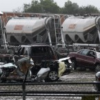 Destroyed vehicles sit in a Kenworth, Texas trailer lot after a tornado that swept through the area. (AP Photo/Tony Gutierrez/PA Images)