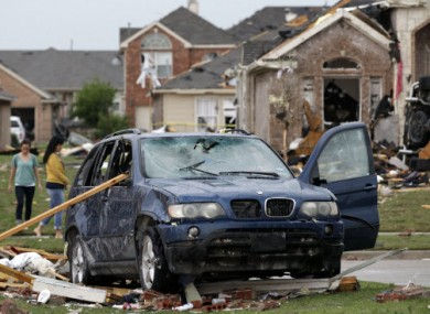 A damaged vehicle and homes in FOrney, Texas after yesterday's storms.