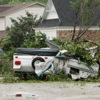 A damaged trailer remains in the street after a tornado swept through the Arlington, Texas yesterday. (AP Photo/Kim Johnson Flodin/PA Images)