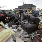 Friends and neighbours help a home owner recover personal items after a tornado struck in Forney, Texas. (AP Photo/Tony Gutierrez/PA Images)