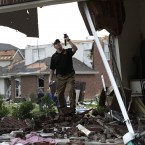 Searching a home after a tornado swept through the area Forney, Texas yesterday. (AP Photo/Tony Gutierrez/PA Images)