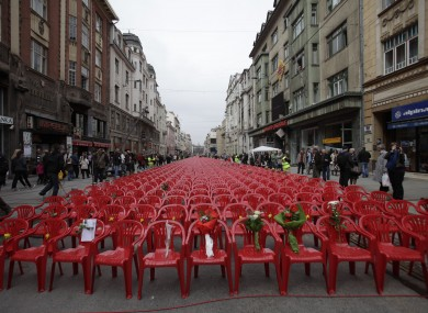 Red chairs on the main street in Sarajevo representing the 11,541 Sarajevans killed during the siege