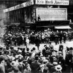 In this April 1912 file photo, crowds gather around the bulletin board of the New York American newspaper in New York, where the names of people rescued from the sinking Titanic are displayed. It was a news story that would change the news. From the moment that a brief Associated Press dispatch relayed the wireless distress call _