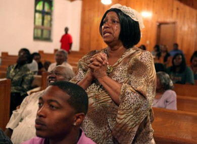 A woman reacts to the news of Zimmerman's arrest at a Florida chapel