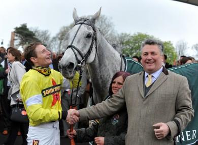 Jockey Daryl Jacob celebrates with Neptune Collonges and trainer Paul Nicholls.