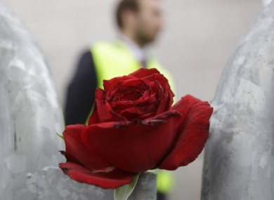 A rose to commemorate the victims of the attacks laid in front of the Oslo court.