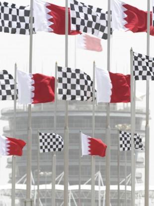 Dust envelops the Bahraini flag-topped tower of the Bahrain International Circuit in Sakhir, Bahrain.