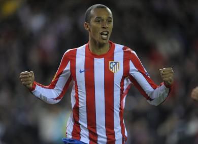 Atletico's Miranda celebrates.