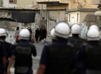 Anti-government protesters shout at riot police yesterday in Sanabis, Bahrain, on the edge of the capital Manama.