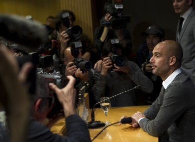 Pep Guardiola faces the press yesterday at the Camp Nou.