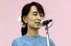 Suu Kyi to attend Burmese parliament after oath dispute resolved