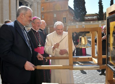 Pope Benedict XVI rings the bell of the International Eucharistic Congress, watched by Fr Kevin Doran and Dr Diarmuid Martin.