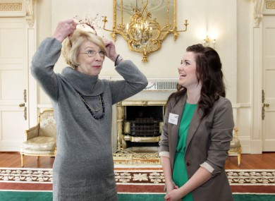 First Lady Sabina Higgins is presented with a hat made by 16-year-old Caoimhe Dowling (right) from Presentation Secondary School in Listowel, Co. Kerry. A group of Young Entrepreneurs from the county were at Áras an Úachtaráin today.