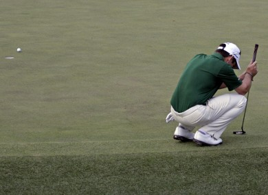 Louis Oosthuizen reacts after missing a putt on the 10th hole.