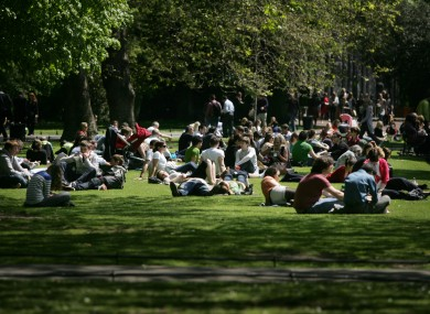 People enjoying the sun in St Stephen's Green yesterday.