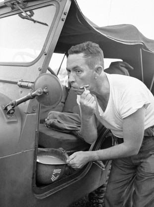 To be fair to this US National Guard sergeant in 1964, he at least got out of his vehicle to perform his morning ablutions...