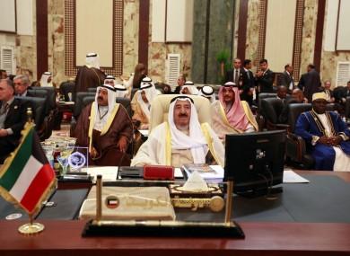 Kuwait's emir, Sheik Sabah Al Ahmad Al Sabah, center, attends the Arab League summit in Baghdad, Iraq, Thursday, March, 29, 2012