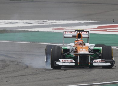 Force India Formula One driver Nico Hulkenberg of Germany locks up his brakes during the Chinese Formula One Grand Prix.