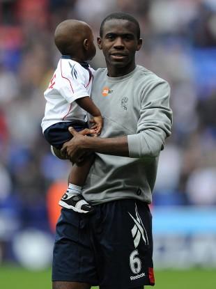 File photo of Fabrice Muamba with his son, Joshua.