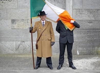 Men avoiding the windy weather at Arbor Hill in Dublin last Sunday