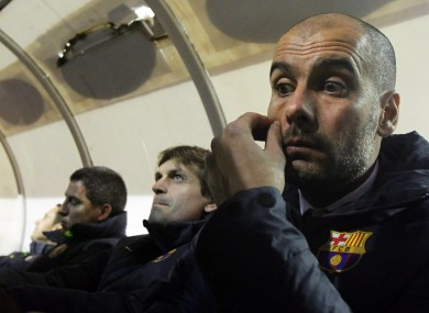 Guardiola gestures besides assistant Tito Vilanova on Sunday night.