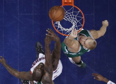 Atlanta Hawks forward Ivan Johnson, left, and Boston Celtics center Greg Stiemsma go up for a rebound.