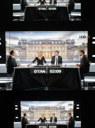 A wall screen shows the televised debate at the TF1 television studio, in Boulogne-Billancourt, outside Paris.