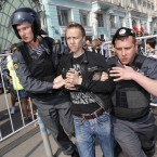 Police detain protesters in downtown Moscow shortly before Vladimir Putin's inauguration today. (AP Photo/Ivan Secretarev)