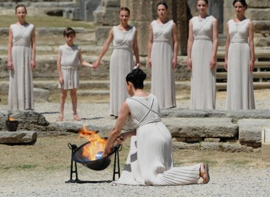 The Olympic Flame is lit by an actress dressed as the High Priestess this morning.