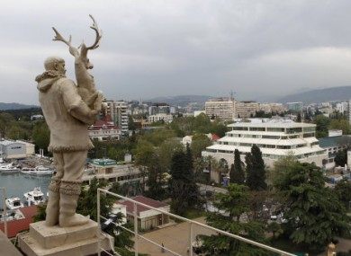 A statue of a reindeer breeder looks out over Sochi, Russia.