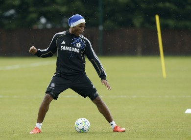 Didier Drogba stands over the ball during a Champions League final training session at Cobham this week.