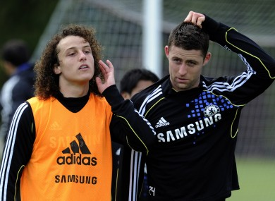 David Luiz, left, and Gary Cahill leave the pitch after a training session at the Cobham training ground yesterday.