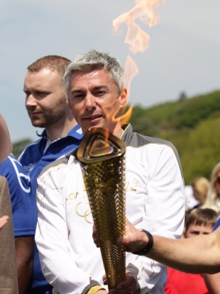 Jonathan Edwards holds the torch.