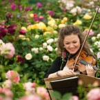 Violinist Marciana Buta performs amid roses by David Austin. (Dominic Lipinski/PA Wire)