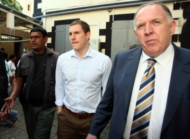 John McAreavey and his father Brendan outside the Supreme Court in Mauritius today.