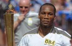 Lap of honour as departing Didier Drogba carries Olympic torch
