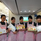 Flight attendants show the specially designed meals and bolsters on the Hello Kitty-themed aircraft. (Photo by ChinaFotoPress/PA)