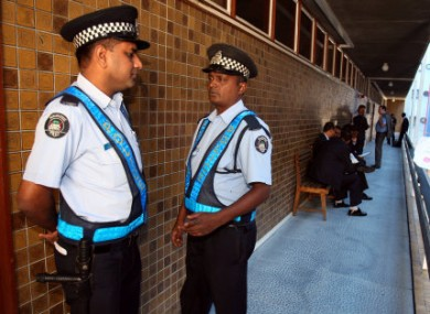 Police outside the Supreme Court in Port Louis, Mauritius today.