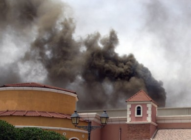 Smoke rising above the Villaggio Mall during yesterday's fire.