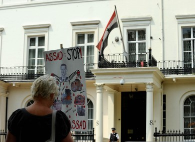 A protest sign outside the Syrian embassy in London today.