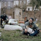 A homeless man and his dog in the garden of a disused house on the edge of London Fields, Hackey, London.   Image: Zed Nelson