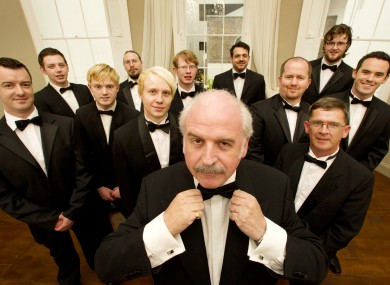 Lookin' sharp: Marty Whelan dressed in his own tuxedo along with volunteers from the Wexford Opera Festival at the National Gallery of Ireland launching the opera festival.