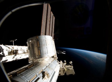 Part of the ISS and Earth photographed from the spacecraft.