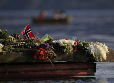 Floral tributes to the Utoya shooting victims, laid near the island last summer.