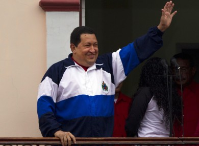 Chavez waves to his supporters from his Miraflores presidential palace in Caracas earlier this year.