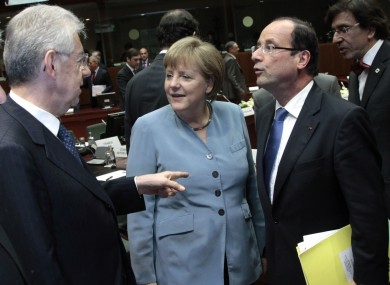 Angela Merkel (centre) is to meet Mario Monti (left) and Francois Hollande (right) later this week to consider allowing the ESM to buy the bonds of member countries.